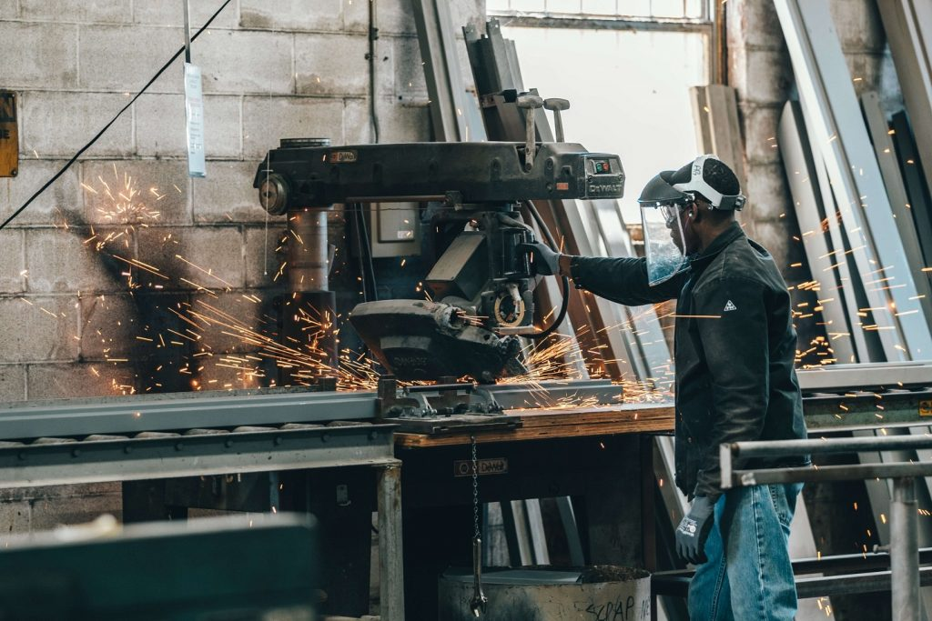 manufacturing worker who needs re-skilling behind a cutting machine