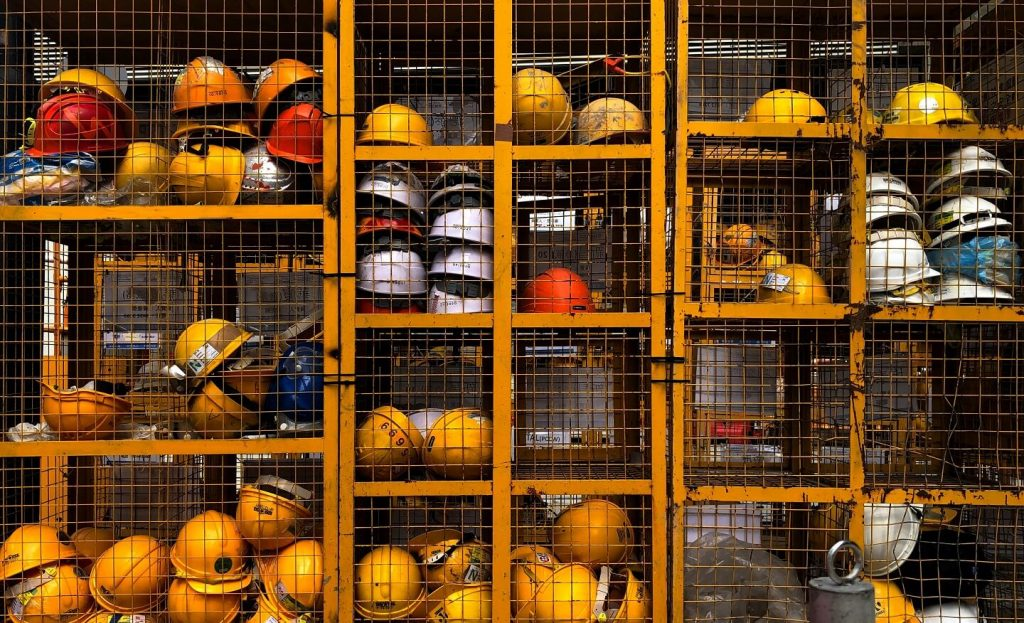 yellow helmets in cages
