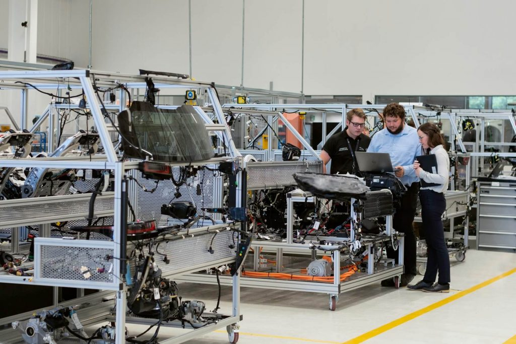 Experts in lean manufacturing reviewing the process
