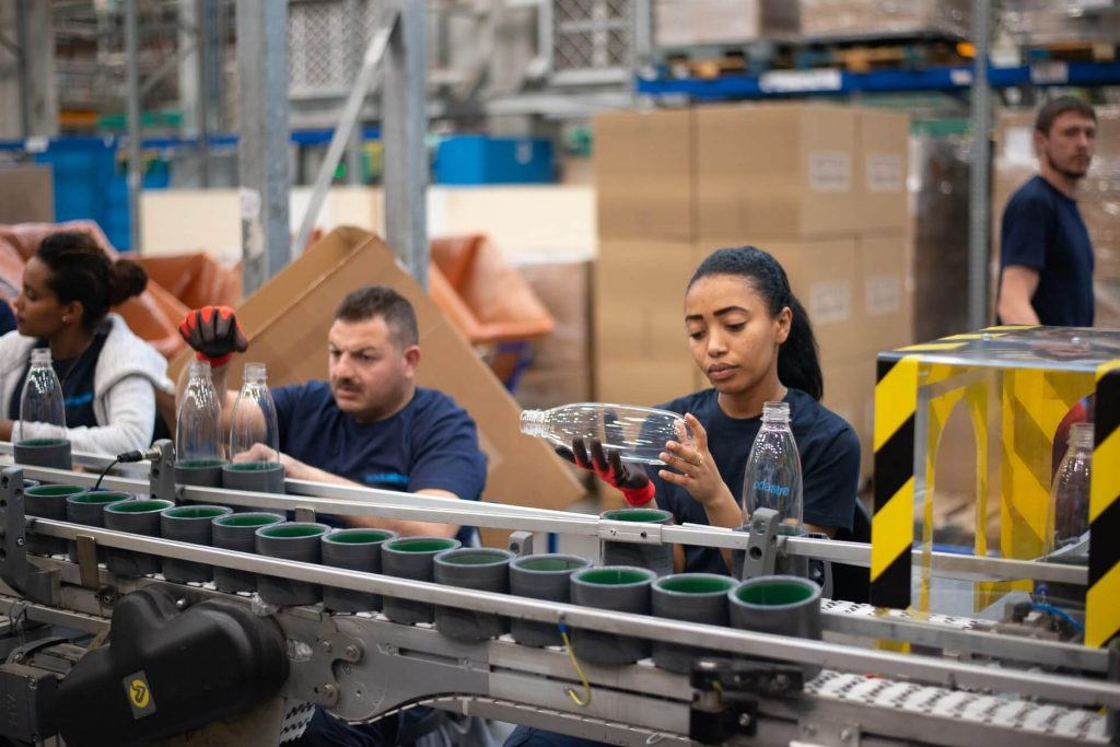woman behind an assembly line