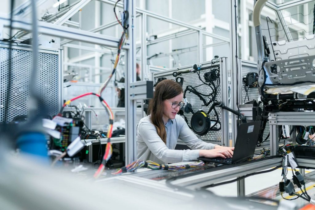 woman in manufacturing preparing different types of training